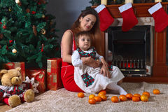 Little girl with mother in the room with Christmas decorations Royalty Free Stock Image