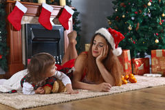 Little girl with mother in the room with Christmas decorations Royalty Free Stock Photography