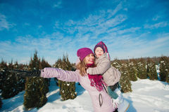 A little girl and mother run and play with the snow, lifestyle, winter holidays stock photo