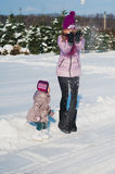 A little girl and mother run and play with the snow, lifestyle, winter holidays Stock Photos