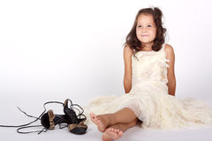 Little girl and mother's shoes Stock Photos