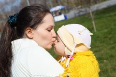 Little girl with mother in spring park Stock Photo