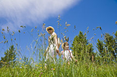 Little girl and mother walking. And in hand in the nature on a summer day Royalty Free Stock Photos