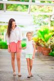 Little girl and mother walking in luxury resort on summer vacation Royalty Free Stock Photos