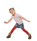 Little girl in motion Stock Photos