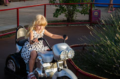 Little girl on motorbike Royalty Free Stock Images