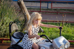 Little girl on motorbike Royalty Free Stock Photos