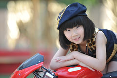 Little girl and motorcycle stock photo