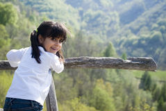Little girl on mountains vacation Stock Image