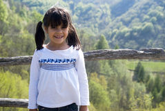 Little girl on mountains vacation Stock Photography