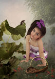 Little girl and mouse in  forest Stock Photo