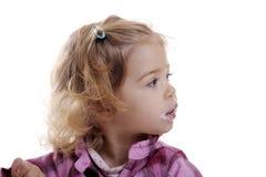 Little girl, mouth full of yogurt Royalty Free Stock Image