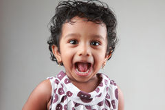 Little girl with mouth open Royalty Free Stock Photography