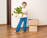 Little girl moving into new house Stock Photo