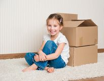 Little girl moving into new house Stock Image