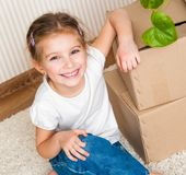 Little girl moving into new house Stock Photos