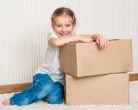 Little girl moving into new house Royalty Free Stock Photography
