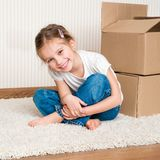 Little girl moving into new house Royalty Free Stock Photo