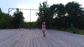 Little girl moving on the wooden stage. She is  represents how the artists were on the stage. stock video