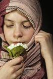 Little girl muffled in a shawl. With flowers Royalty Free Stock Images