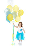 Little girl with multicolored balloons. Stock Photography
