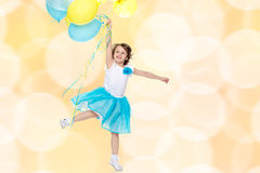 Little girl with multicolored balloons. royalty free stock image