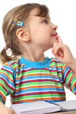 Little girl in multicolored shirt with notebook stock photos