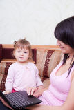 Little girl with mum Royalty Free Stock Images