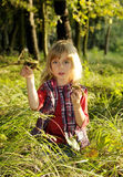 Little girl with mushrooms Royalty Free Stock Photos
