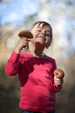 Little girl with mushrooms Royalty Free Stock Images