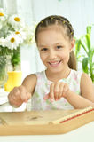 Little girl with Music instrument gusli Stock Photos