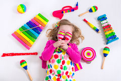 Little girl with music instruments Royalty Free Stock Image
