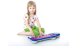 The little girl with a musical toy Royalty Free Stock Images
