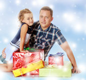 Little girl with my dad about gifts. Royalty Free Stock Photography