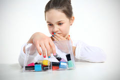 Little girl and nail. Polishes Stock Photography