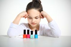 Little girl and nail. Polishes Stock Image