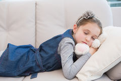 Little girl napping on the couch Stock Photo
