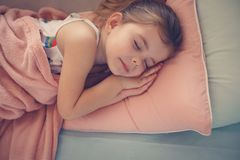 Little girl napping on couch. stock photography