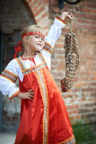 Little girl in national costumes with bast. Little girl in national costumes in Russian village on summer day stock image
