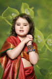 A little girl is in the national Indian dress. A little girl is in the national Indian suit Royalty Free Stock Photo