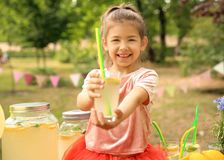 Little girl with natural lemonade in park Royalty Free Stock Image