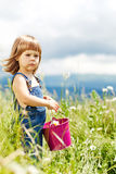 Little girl in nature. Boy and girl in flowers Stock Images