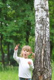 Little girl on nature Stock Images