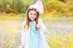 Little girl on the nature with butterfly net Royalty Free Stock Image
