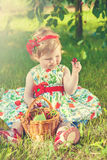 Little girl on nature with cherries Royalty Free Stock Images