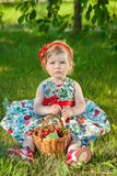Little girl on nature with cherries Stock Images