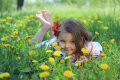 Little girl on nature. Stock Photos