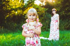 Little girl on nature with the mother royalty free stock photo