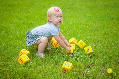 Little girl on nature playing toy Royalty Free Stock Photography