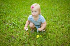 Little girl on nature playing toy Royalty Free Stock Images